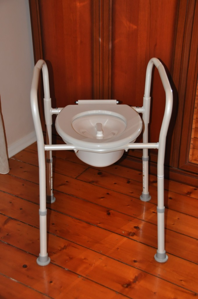 Overtoilet aid folding with splash guard for elderly, seniors, aged ...